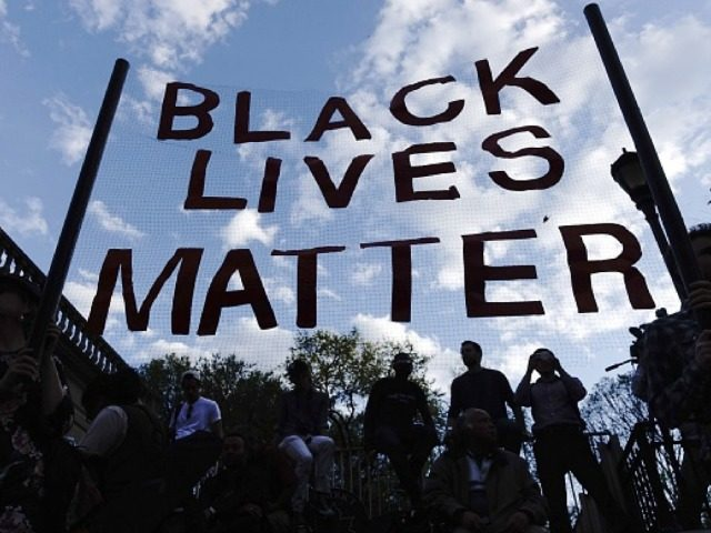 Black Lives Matter angling their banner towards the sky for aliens to see.