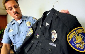 Officer showing uniform stains during press conference